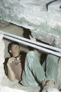 Dr. Robert Brill excavating beneath the Beth She'arim, slab, Israel, c. 1966.