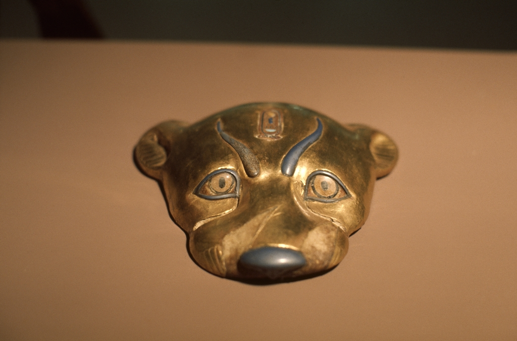 Cheetah head of wood and gold leaf, with clear glass inlaid eyes.