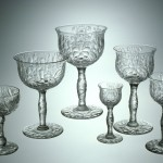 Six piece place setting. Libbey Glass Company, United States, Toledo, Ohio, 1903-1904. Colorless, blown and engraved. H: 16.5 cm. Collection of The Corning Museum of Glass (69.4.33)
