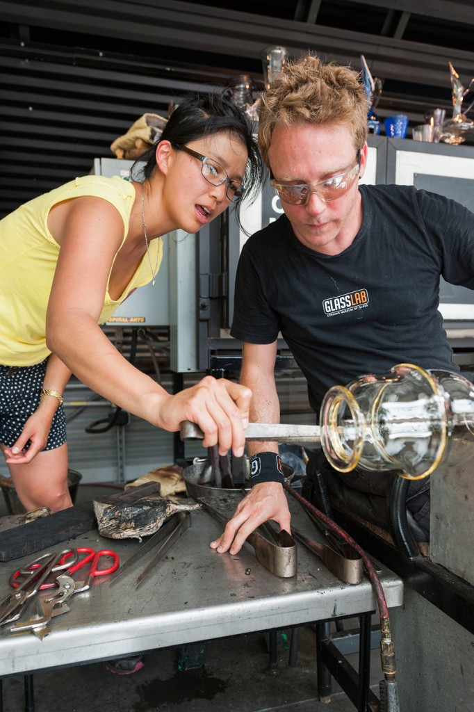 Helen Lee works on a glass vessel at GlassLab on Governors Island