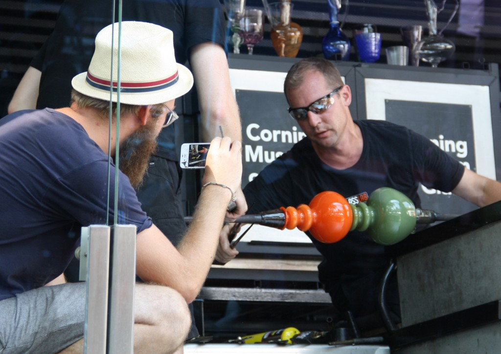 Designer Mike Perry documents Eric Meek working on his glass design at GlassLab
