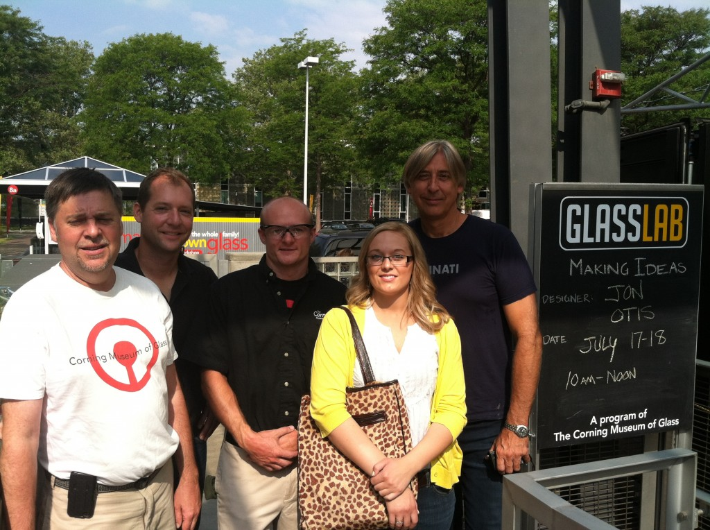 Image caption: From right to left is GlassLab designer Jon Otis, me, G. Brian Juk (gaffer), Hot Glass Show supervisor Eric Meek, and hot glass programs manager Steve Gibbs, at The Corning Museum of Glass.