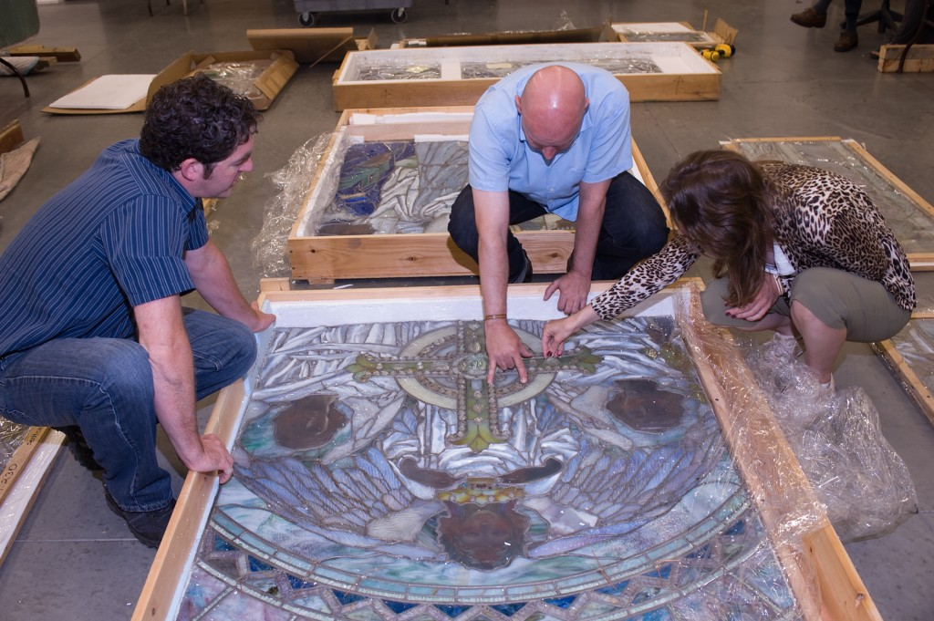 Warren Bunn, CMOG's manager of exhibitions and collections examines the window pre-conservation with Drew Anderson, conservator at the Metropolitan Museum of Art and independent curator Diane Wright.