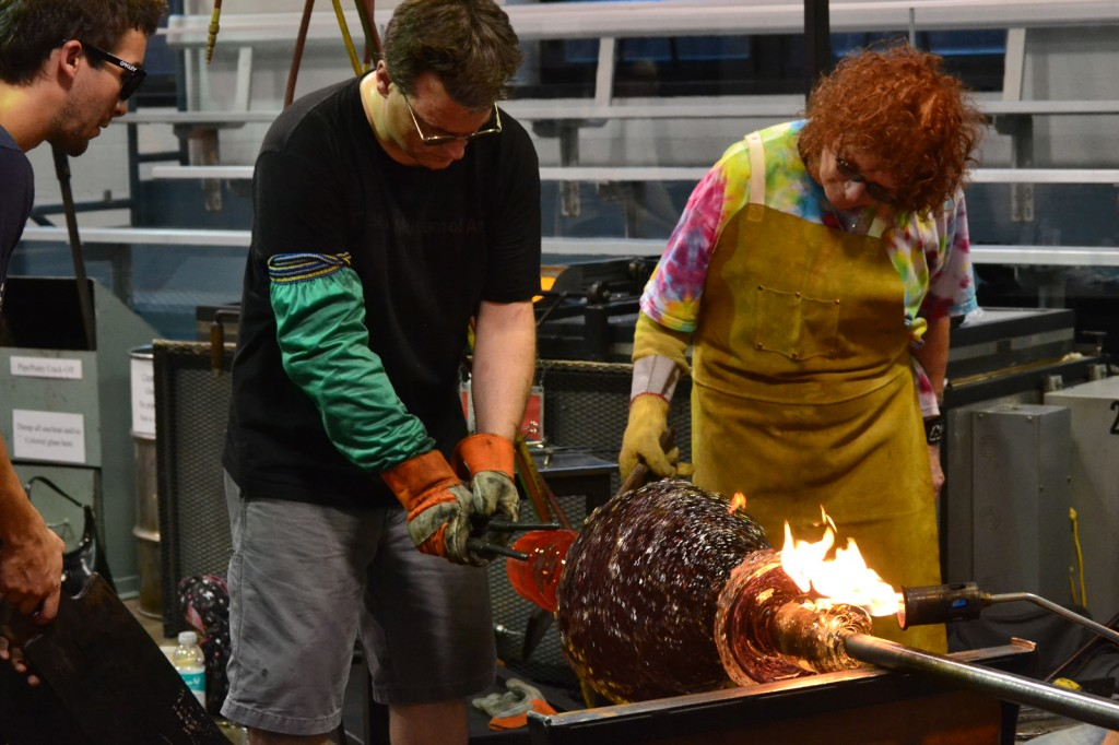 Laura Donefer and Jeff Mack working with hot glass at Corning