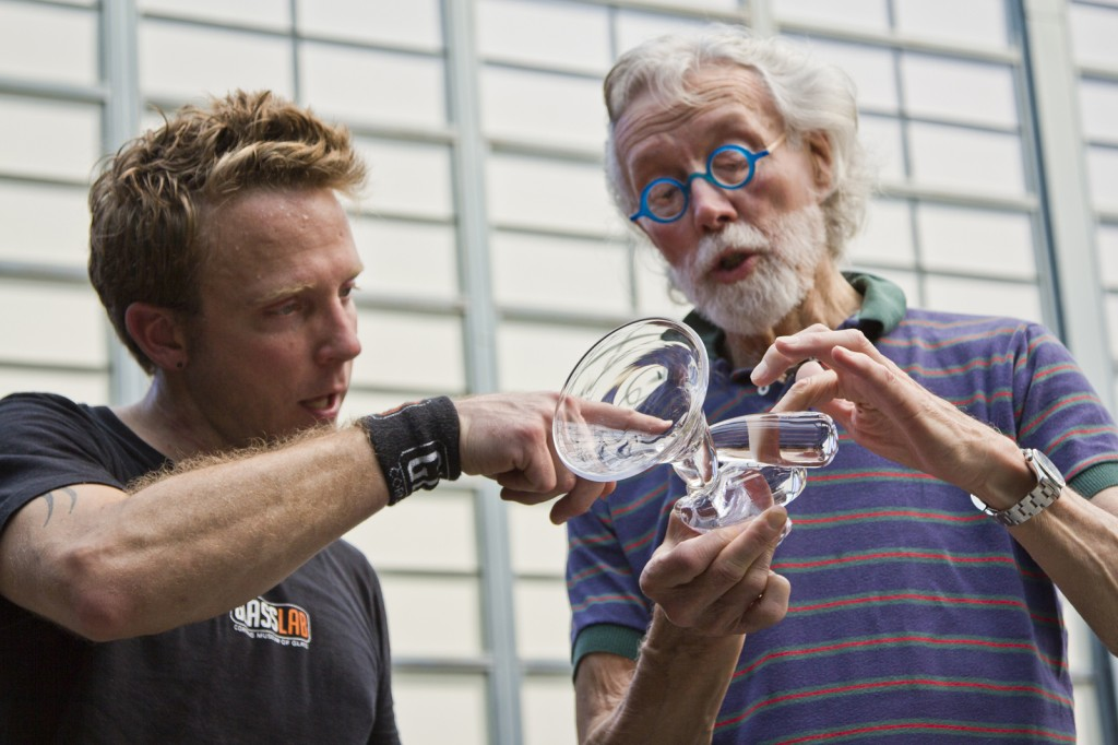 Gaffer Chris Rochelle and designer Wendell Castle confer on the elipsoid martini glass at GlassLab