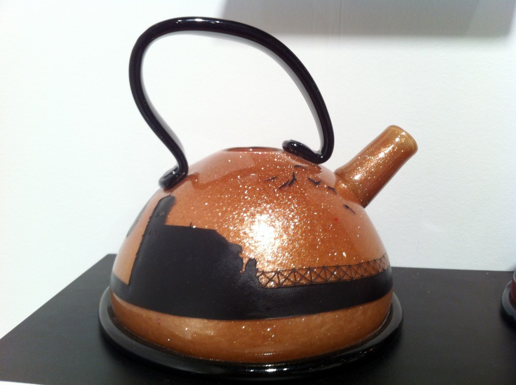 Nadine's gold adventurine teapot on display at Riley Gallery's booth.