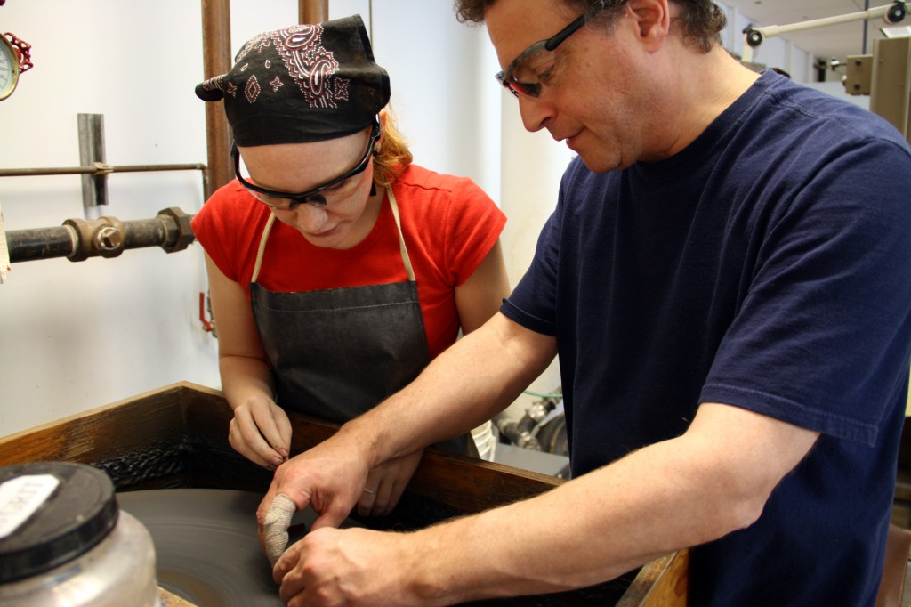 Don Friedlich instructs Lindsay Woodruff on the flat wheel at The Studio