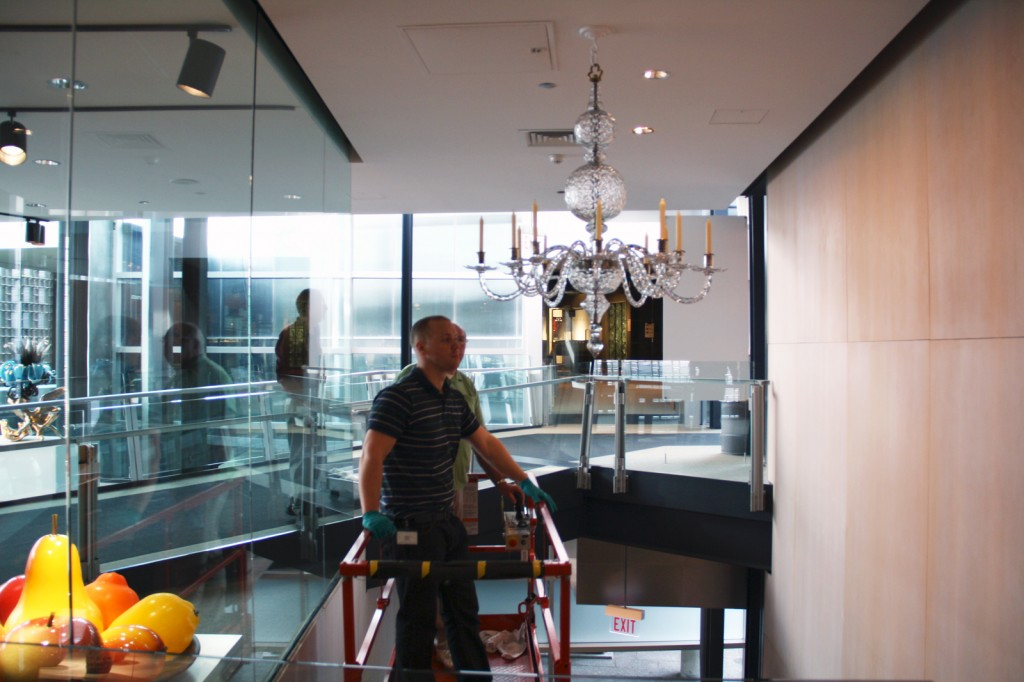 Installing the chandelier in the Crossroads
