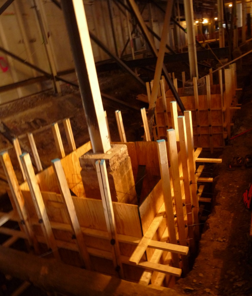 The forms are plywood supported with 2x4s.  Vertical 2x4s are studs.  Horizontal 2x4s are wales.