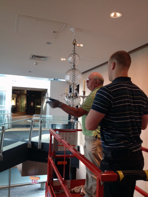 Museum preparators Fritz Ochab and Stefan Zoller carefeully install each drip plate.