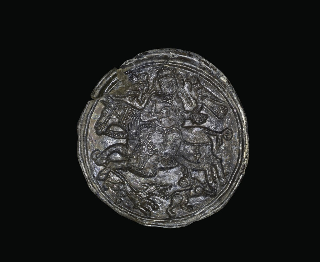 Medallion with Falconer, Islamic, Central Asia, 12th century. Stamped. Diam. 9.1 cm, Th. 0.4 cm. (2011.1.1)
