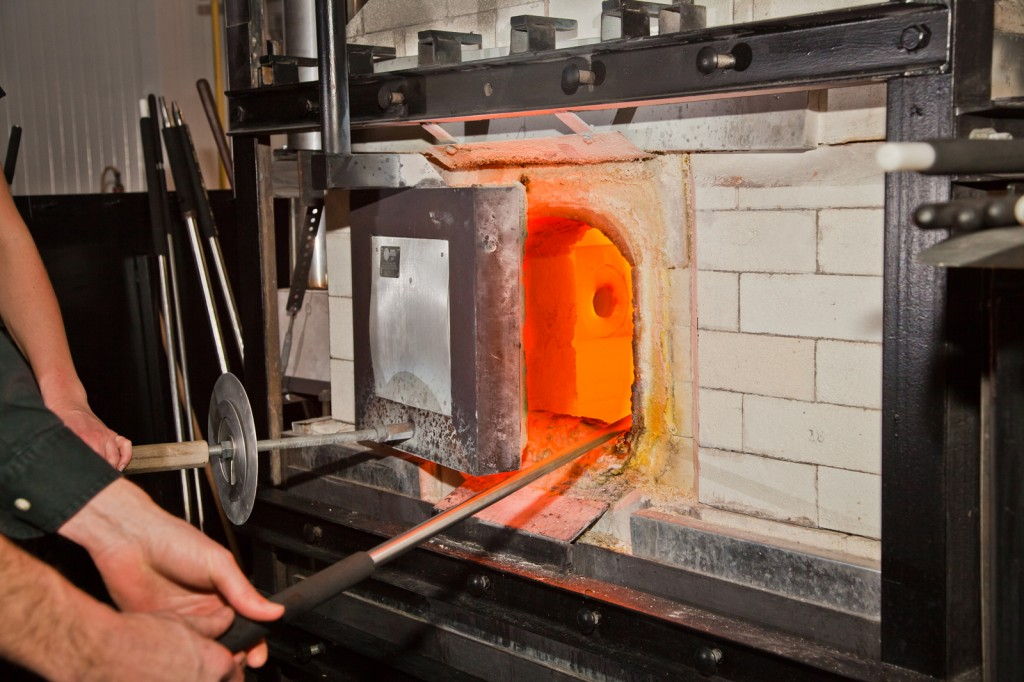 Glass in furnace is melted to 2100 degrees F.