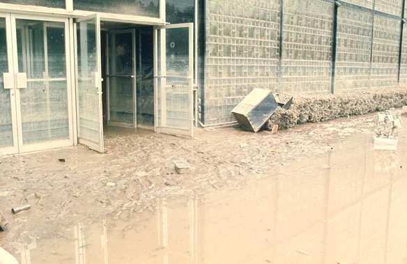 Flood-damaged exterior of Corning Glass Center Rakow Research Library, The Corning Museum of Glass, photographer unknown