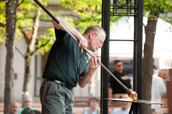 Carl blowing glass at Corning's GlassFest