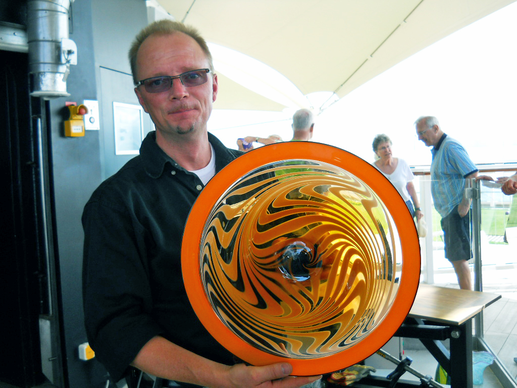 Carl Siglin with a glass platter made onboard a Celebrity Cruise ship