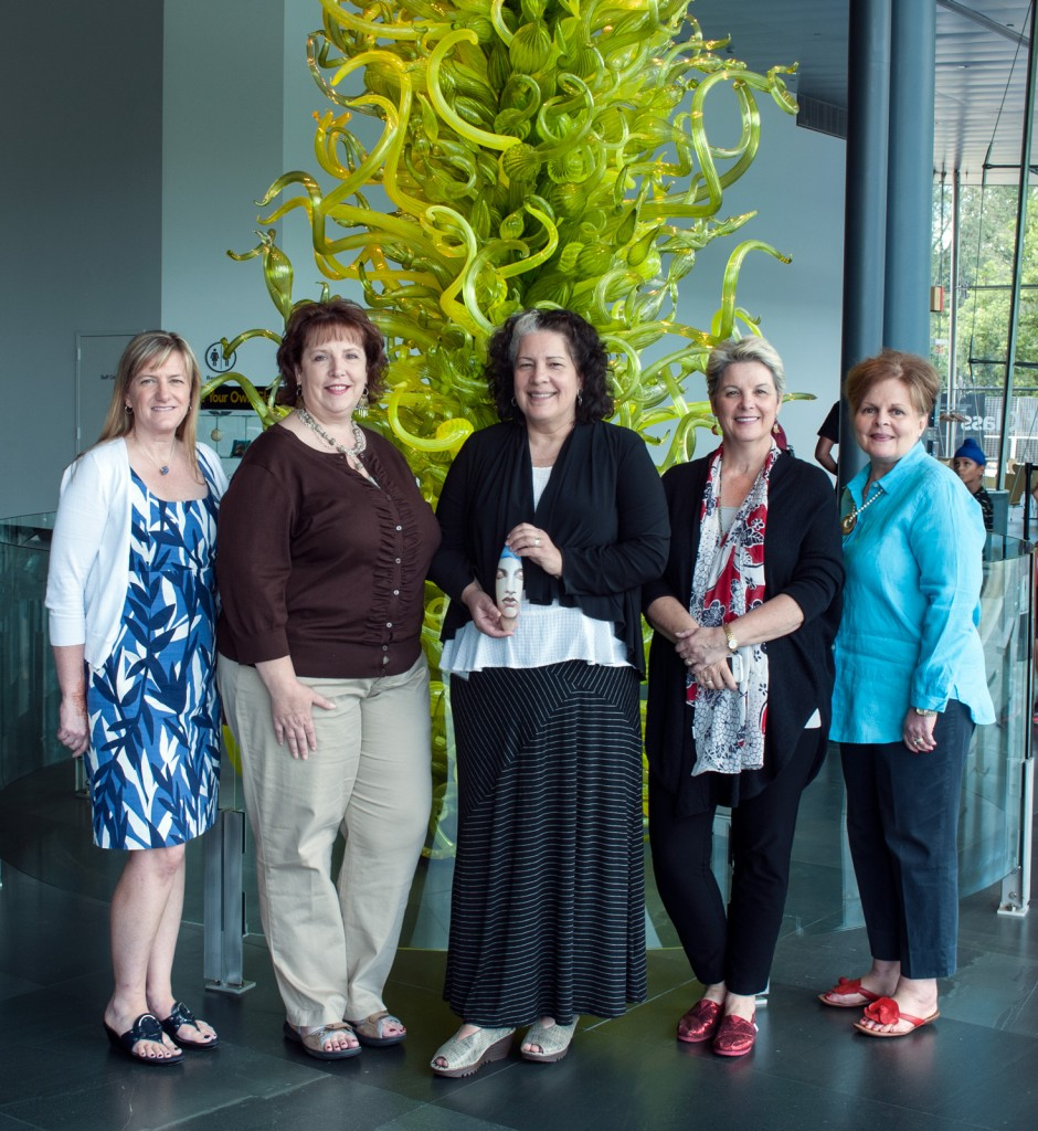Left to right: Susan Sheehan, ISGB vice-president; Angie Ramey, ISGB president; Tina Oldknow, curator of modern glass; Karol Wight, executive director; and Kendra Bruno, ISGB executive director. The gift included a large, painted bead by Israeli artist Ronit Dagan (held by Tina Oldknow).