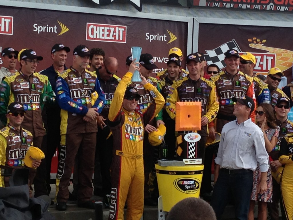 Glassmaker Eric Meek was at The Glen's victory lane to present the trophy to race winner Kyle Busch.
