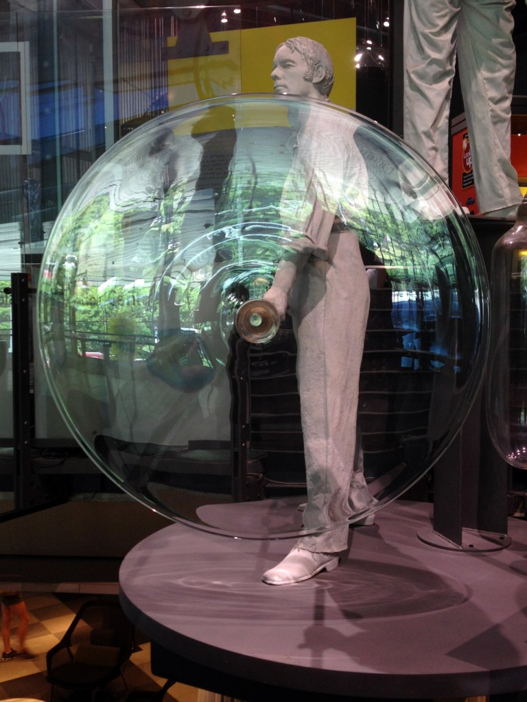 Model of a glassblower spinning a sheet of crown glass in the Museum's Innovation Center