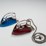 Silver Streak Iron Insert (blue) and Silver Streak Electric Iron (red), United States, Corning, NY, Corning Glass Works; Saunders Machine and Tool Corporation, made in 1946; designed in 1943; Blue: H: 11.7 cm, W: 21.6 cm, D: 9.6 cm; Red: H: 12.5 cm, W: 22.7 cm, W: 9.8 cm (65.4.3, gift of Otto Hilbert; 2005.4.22).