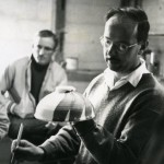 Littleton applying slip to a ceramic bowl, with Tom McGlauchlin in the background (Marvin Lipofsky Archive, Rakow Library, The Corning Museum of Glass).