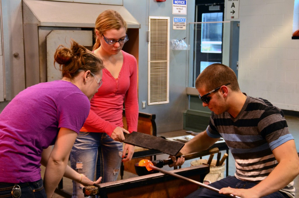 Students from the High School Learning Center practice the basics of glassblowing