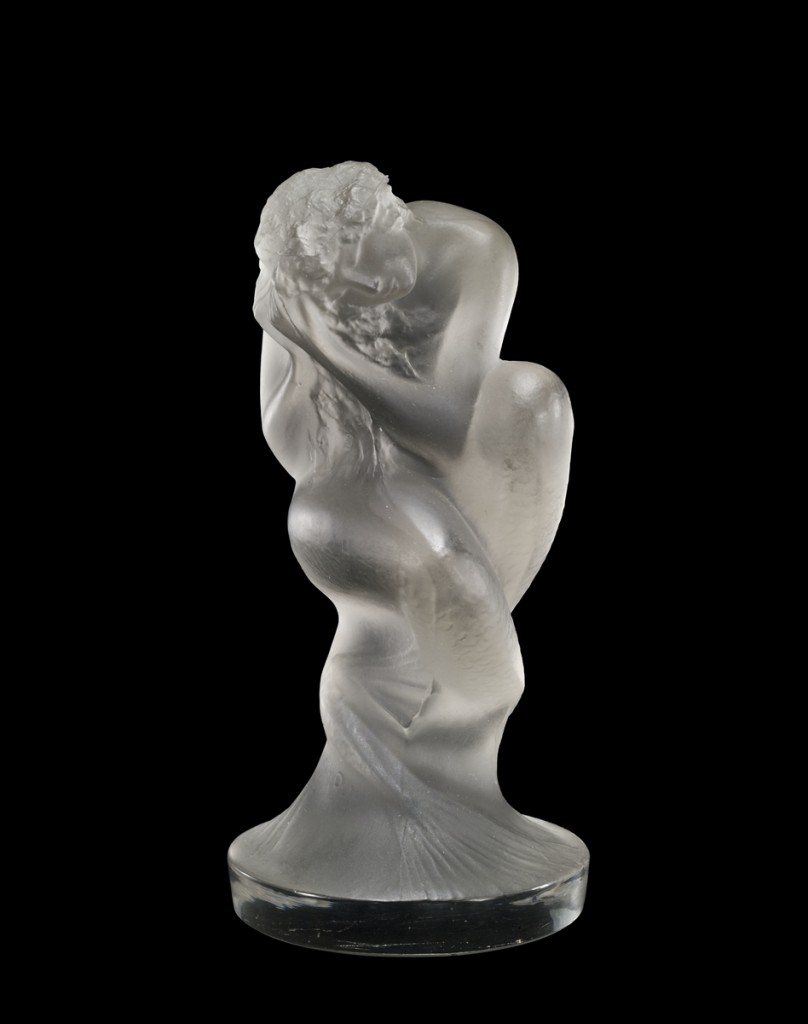 Automobile Mascot or Statuette, Sirène (Mermaid), mold-pressed glass, acid-etched. René Lalique (French, 1860–1945).  France, Combs-la-Ville, designed 1920. H. 10.4 cm, W. 5.6 cm, D. 5.9 cm. The Corning Museum of Glass (2011.3.291, gift of Elaine and Stanford Steppa)