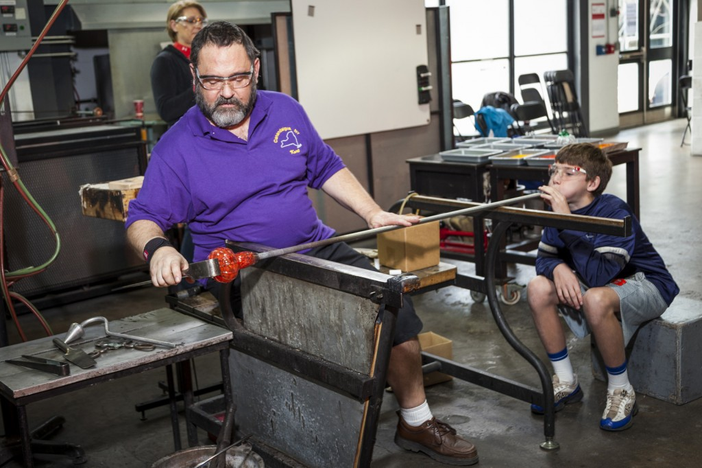 Kurt Carlson assisting glassblowing at a special program at Make Your Own Glass.