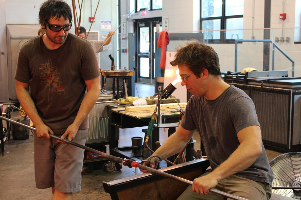 Moshe Bursuker and Jamie Harris work together to create two chandeliers during their residency at The Studio.