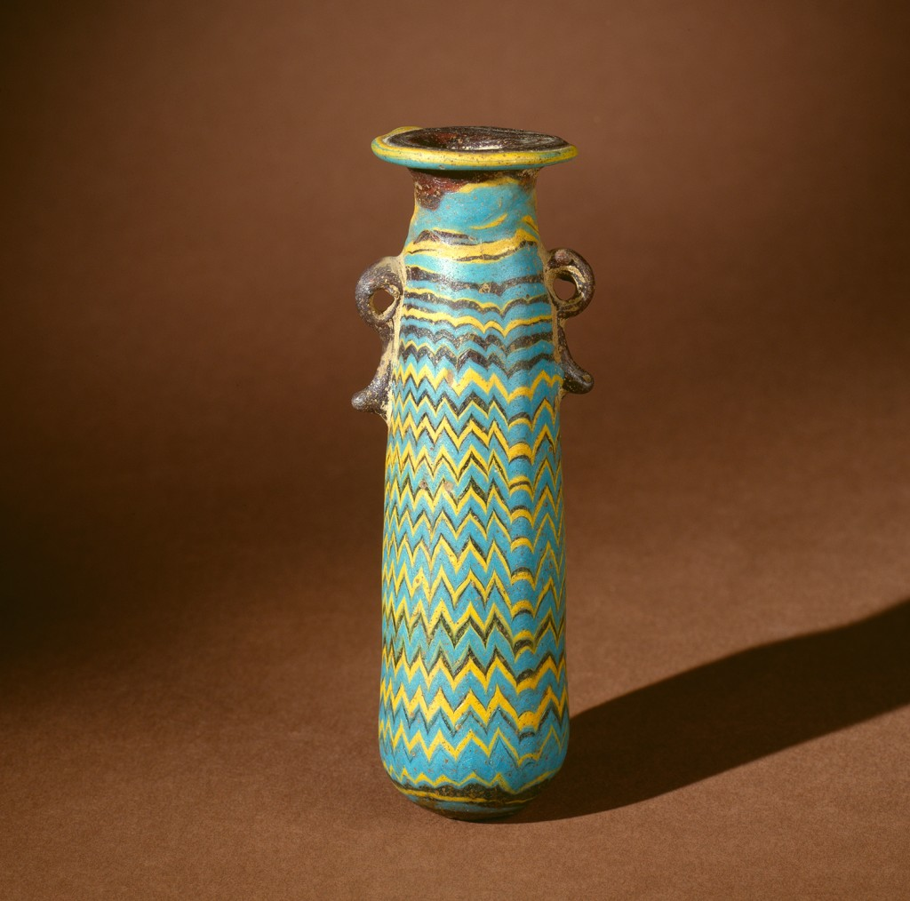 Perfume bottle, core-formed, trailed.  Eastern Mediterranean, 599-400 BC.  H: 9.5 cm; Rim Diam: 3 cm. 50.1.5.