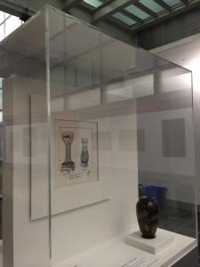 Rakow Library exhibit 2014. Tiffany vase and drawing on display.