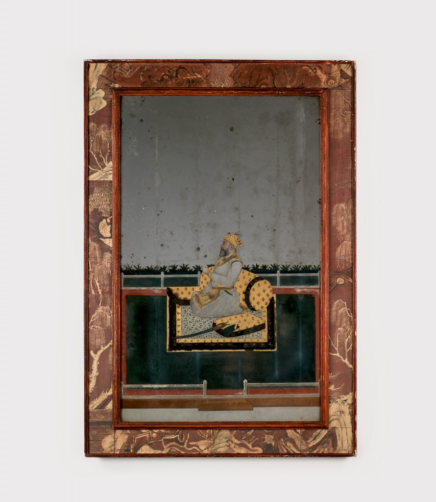 A reverse-painted portrait on mirror glass of a Mughal nobleman on a terrace, perhaps Nawab Shahamat Jang. Possibly Calcutta, West Bengal, India, 1760-80. Opaque pigments heightened with gold and silver, painted in reverse on glass and silvered, in a 20th century chinoiserie frame. 2014.6.18