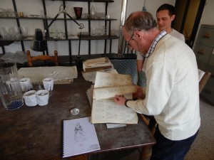 Mario and Domenico examining one of the many catalogs of engraving designs at SALIR