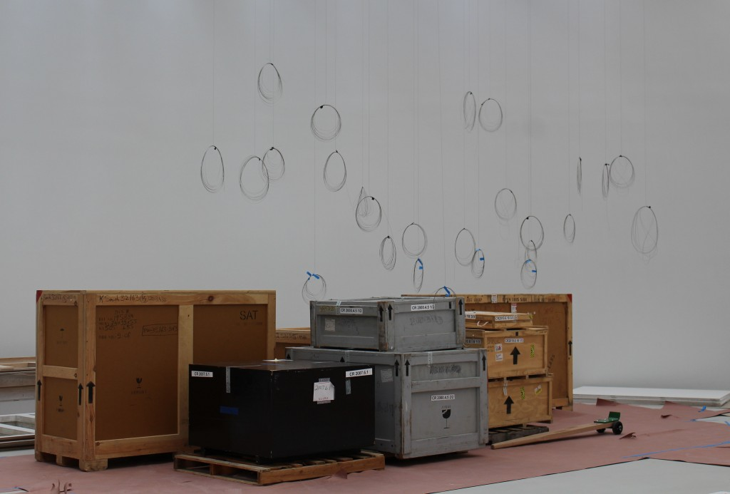 """Lino Tagliapietra's Endeavor sits in crates waiting to be installed. Gallery preparators have """"sketched out"""" with wire rings how it will hang."""