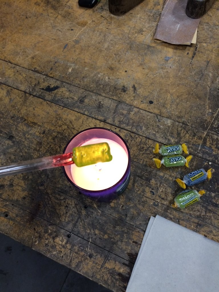 The initial candy-glass studio with candle, glass tube, and candy.