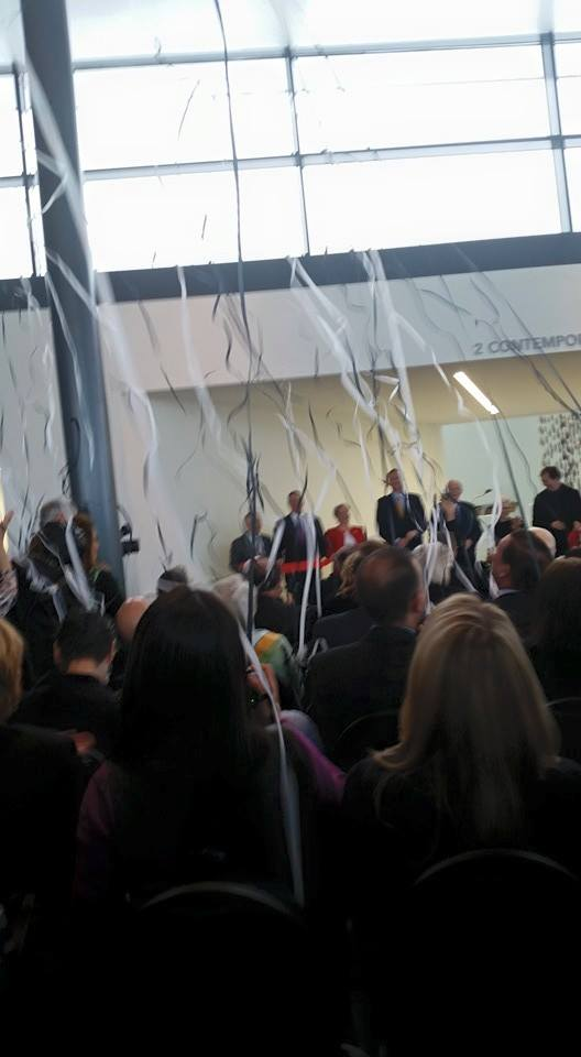 Streamers fall as the curtain officially drops on the new Contemporary Art + Design Wing