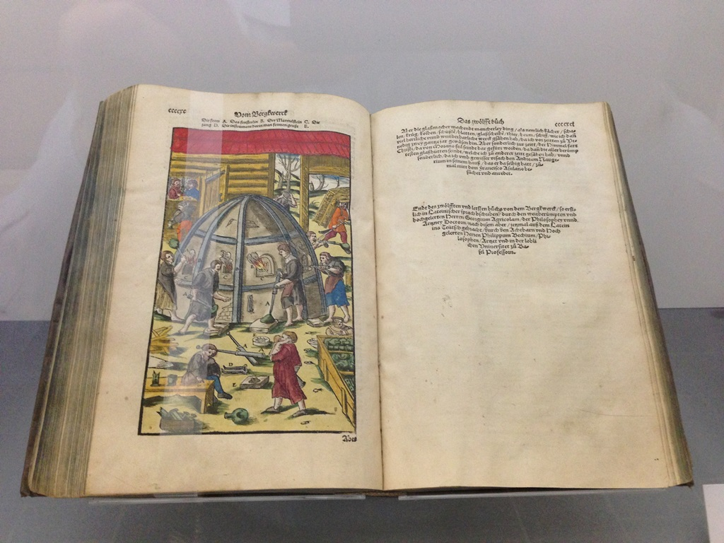 Currently on exhibit is a book by Georg Agricola, Berckwerch Buch, published in 1580, that has a beautiful hand-colored illustration of glass blowing. (photo by Jim Galbraith)