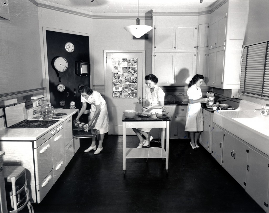 Helen Martin, Lilla Cortright, Mary Alice Dailey prepare foods to be photographed in Pyrex Dishes. Photography by Ayres Stevens, published in Corning Glass Works Gaffer, October 1946. Courtesy of Corning Incorporated, Department of Archives and Record Management.