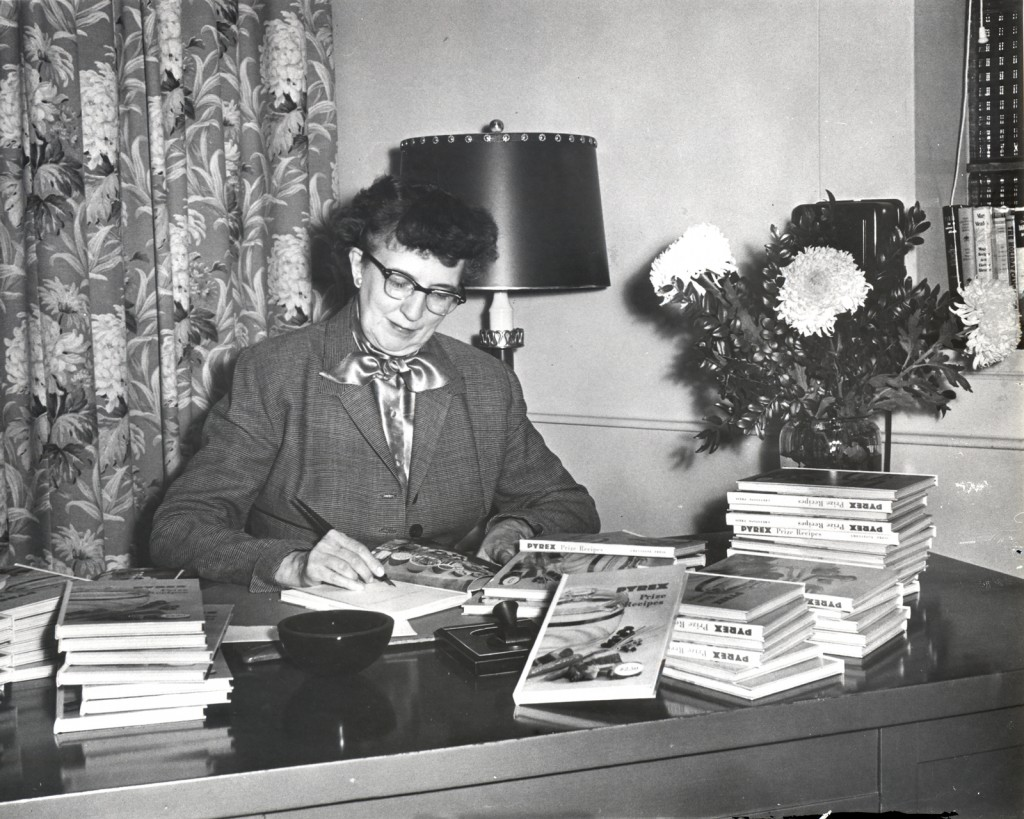 Lucy Maltby signing copies of her cookbook, Pyrex Prize Recipes, 1953. Courtesy of Corning Incorporated, Department of Archives and Record Management CMGL 144704.