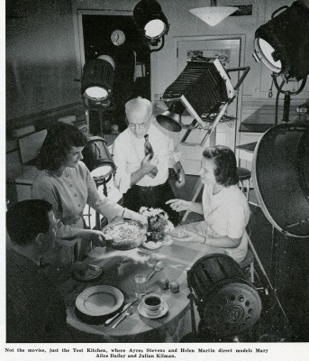 Photographer Ayres Stevens and test kitchen staff member Helen Martin film Mary Alice Dailey and Julian Kilman in the Corning Glass Works Test Kitchen. The Gaffer, October 1946. Courtesy of the Corning Incorporated Department of Archives & Records Management, Corning, NY.