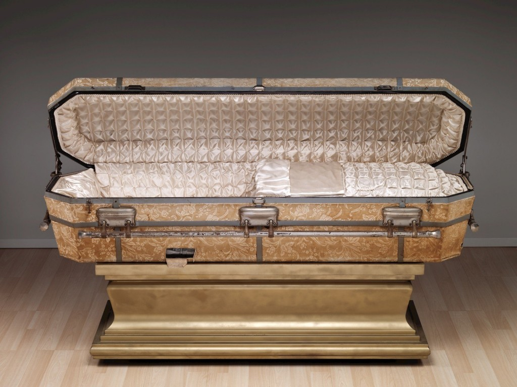 Casket with Stand, manufactured by the DeCamp Consolidated Glass Casket Co., Muskogee, OK, 1920-1929. Gift of Fred Hunter. 2001.4.234.