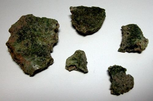 5 Bits of Trinitite Glass, United States, White Sands, NM, 1945. Gift in memory of Stephen P. Tooney, 2006.4.237.