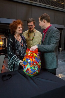 Laura Donefer, Jeff Mack, and Eric Meek look at the piece made during the opening of the Contemporary Art + Design Wing
