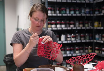 Nadina Geary forms a wax positive from wax sprues, which are long wax rods that come in different shapes and thicknesses