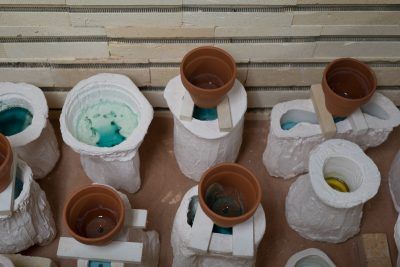 The plaster casts rest in the kiln before students remove them to start unearthing their glass pieces.