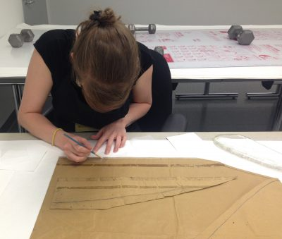 Bonnie prepares Japanese tissue with a neutral conservation grade adhesive to re-attach the removed kraft paper piece.