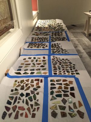 More than 1,000 pieces of surviving Tiffany glass were unpacked and laid out for installation on the workroom table.