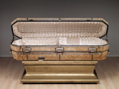 Glass casket on stand