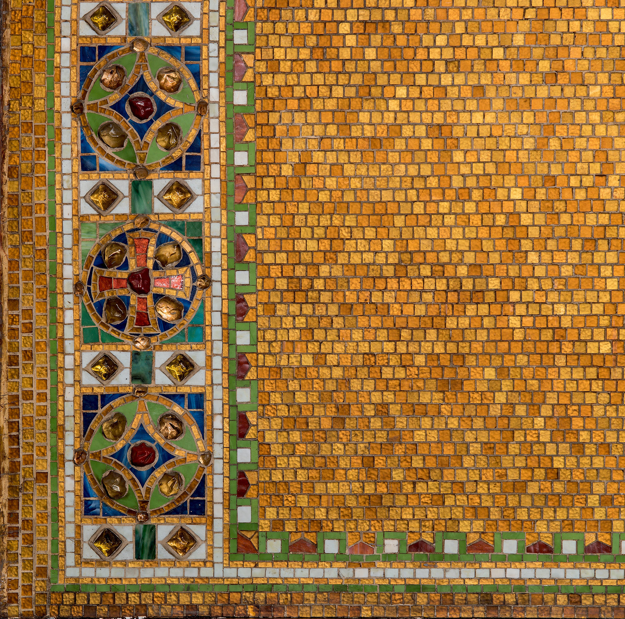 """Detail of reredos with cross, after 1910. Tiffany Studios. Glass mosaic with glass """"jewels."""" Christ Episcopal Church, Corning, New York."""