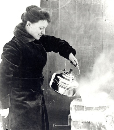 Photo of Roberts pouring boiling water on a piece of Pyrex