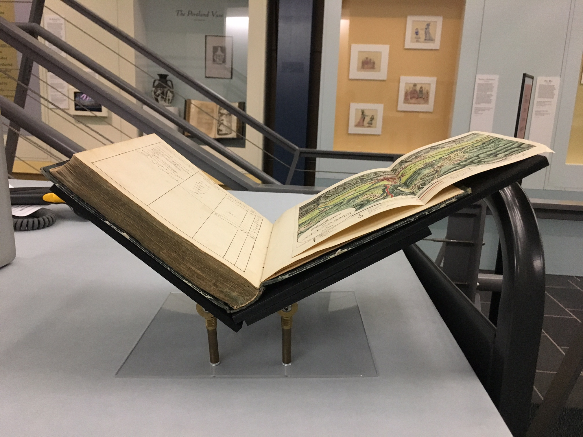 An example of a book resting on a custom book mount.